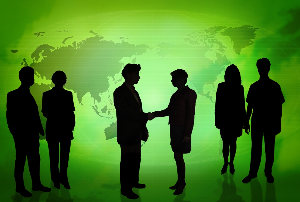 Business_People_In_Front_Of_A_Green_Map